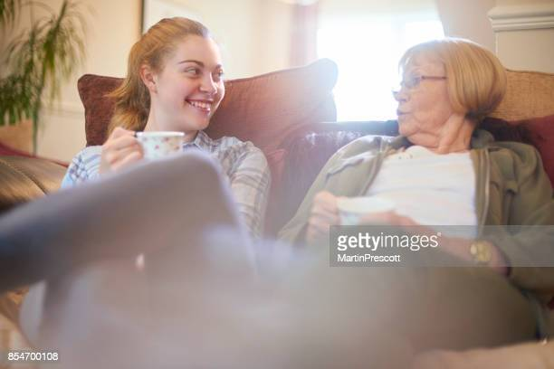 visiting grandmother - british granny stock photos and pictures