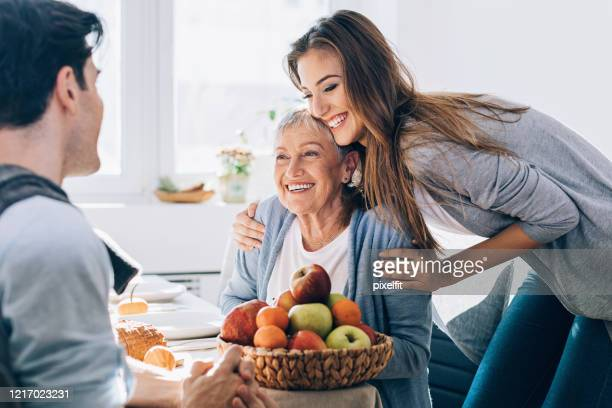 visiting grandmother's home - mother in law stock pictures, royalty-free photos & images