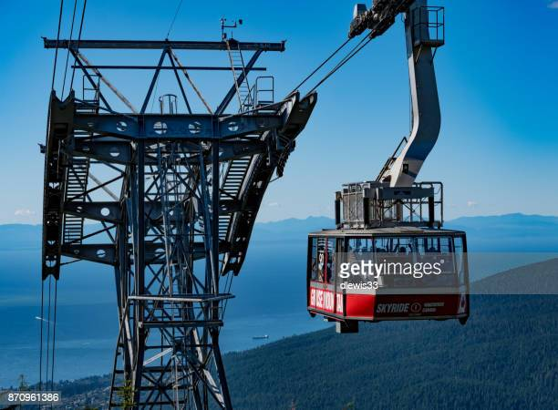 visiting grouse mountain, vancouver - grouse mountain stock photos and pictures