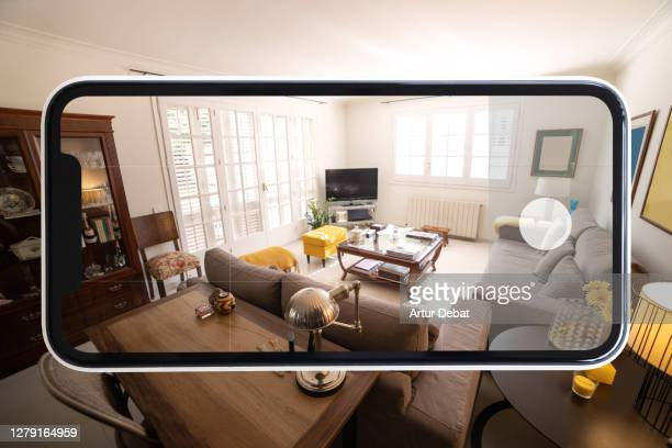 visiting home interior using mobile phone with virtual reality technology. - photo messaging stock pictures, royalty-free photos & images