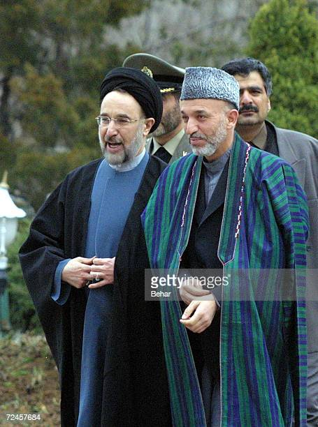 Visiting Interim Afghan leader Hamid Karzai walks with Iranian President Mohammad Khatami during an official welcoming ceremony February 24, 2002 in...