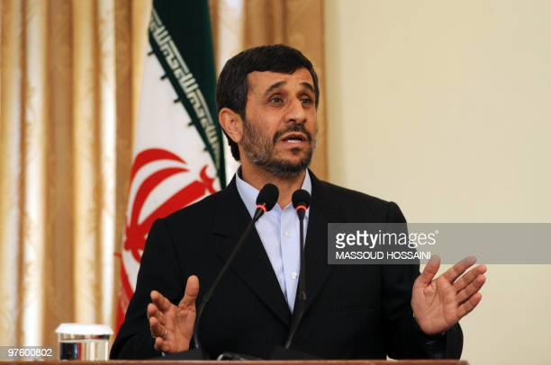 Visiting Iranian President Mahmoud Ahmadinejad speaks at a joint press conference with unseen Afghan President Hamid Karzai at the presidential...
