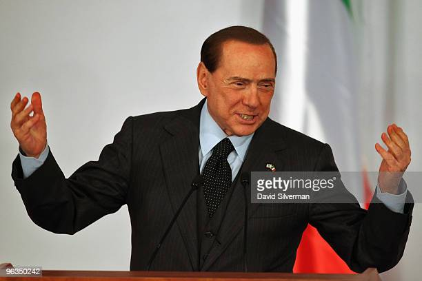 Visiting Italian Prime Minister Silvio Berlusconi gestures during a press conference with his Israeli counterpart and host Benjamin Netanyahu...