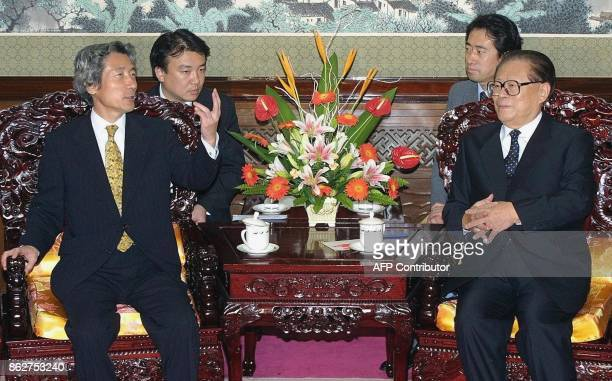 Visiting Japanese Prime Minister Junichiro Koizumi gestures as he holds talks with Chinese President Jiang Zemin at the Zhongnanhai leadership...