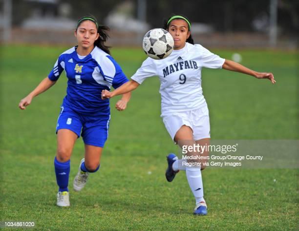 LAKEWOOD Visiting La Mirada girls soccer beat Mayfair 31 LM's Alyssa Hernandez left and Mayfair's Tatiana Avila converge on the ball