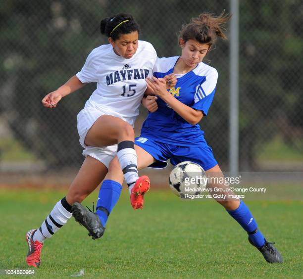 LAKEWOOD Visiting La Mirada girls soccer beat Mayfair 31 Mayfair's Ashli Villalobos collides with Maxine Langenberg as they converge on the ball