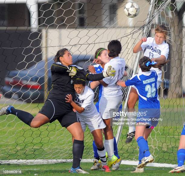 LAKEWOOD Visiting La Mirada girls soccer beat Mayfair 31 On a corner kick Mayfair's Alyssa Tafoya upper right heads the ball in for a goal as LM...