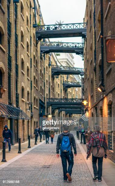 visiting london's shad thames - old london stock photos and pictures