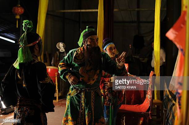 Visiting mainland Chinese performers take part in a Chinese opera during a Hungry Ghost festival in Malaysia's northern town of Bukit Mertajam on...