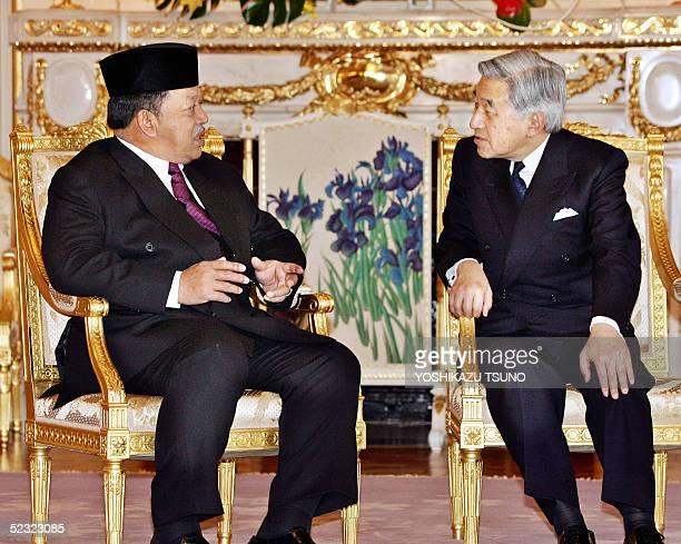 Visiting Malaysian King Tuanku Syed Sirajuddin talks with Japanese Emperor Akihito as they bid farewell at the Akasaka Guesthouse in Tokyo 09 March...