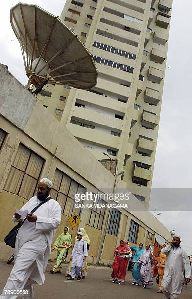Visiting members of an Islamic Shia gathering of the Bohra community walk to prayers in the capital Colombo 11 January 2008 Some 30000 Bohras are...