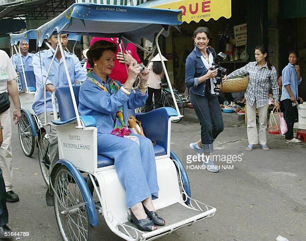 Visiting Norwegian Queen Sonja takes pictures as she enjoys a city tour by cyclo in the old quarter of Hanoi, 02 November 2004. King Harald V and...