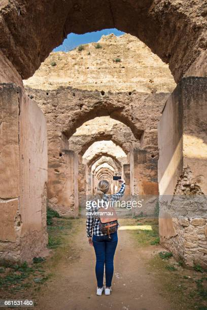 visiting old moroccan granary - moroccan girls stock photos and pictures