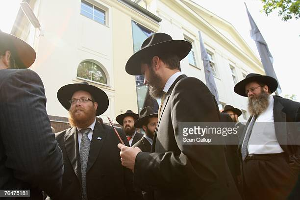 Visiting Orthodox rabbis gather outside Szloma Albam House during its inauguration September 2 2007 in Berlin Germany Szloma Albam House which...