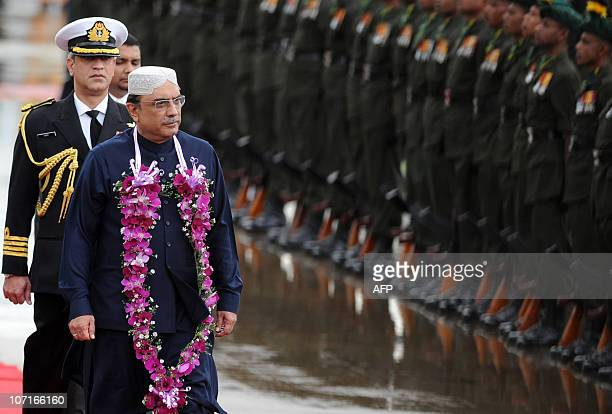 Visiting Pakistan President Asif Ali Zardari inspects a Sri Lankan Army guard of honour during a welcoming ceremony in Katunayake on November 27,...