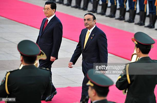 Visiting Pakistan President Asif Ali Zardari walks beside Chinese President Hu Jintao past the military band during a review of the honour guard at a...