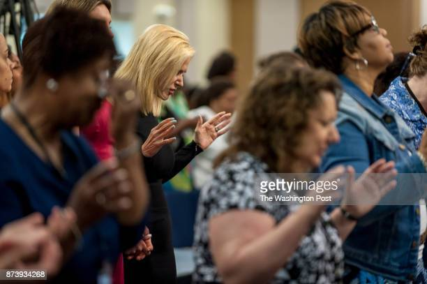 Visiting Pastor Paula White a Pentecostal Christian televangelist prays before giving a sermon to the congregation at Hope Christian Church on July...