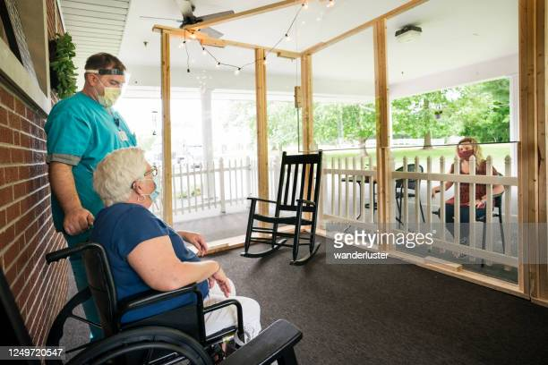 visiting patients face to face safely at a nursing home - visit stock pictures, royalty-free photos & images