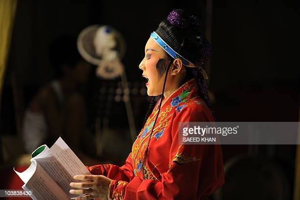 A visiting performer from mainland China takes part in a Chinese opera during the Hungry Ghost festival in Malaysia's northern town of Bukit Mertajam...
