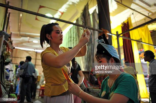 "Visiting performers from mainland China prepare to take part in a Chinese opera during a ""Hungry Ghost"" festival in Malaysia's northern town of Bukit..."