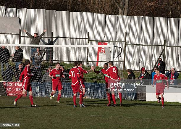 Visiting players and supporters celebrating their team's second goal at Garden Walk Stadium, during the FA Vase 4th round tie between Gornal Athletic...
