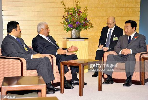 Visiting Qatar Deputy Prime Minister Abdullah bin Hamad AlAttiyah accompanied by Qatari Energy Minister Mohammed Saleh AlSada talks to Japanese Prime...