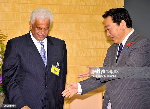 Visiting Qatar Deputy Prime Minister Abdullah bin Hamad AlAttiyah is greeted by Japanese Prime Minister Yoshihiko Noda for their talks at Noda's...