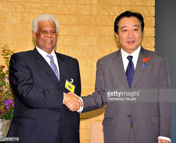 Visiting Qatar Deputy Prime Minister Abdullah bin Hamad AlAttiyah shakes hands with Japanese Prime Minister Yoshihiko Noda prior to their talks at...