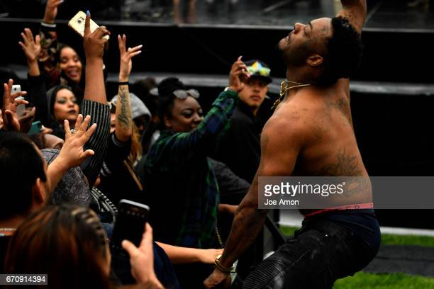A visiting rapper gets the attention of the ladies during one of his songs at the Denver 420 Rally at Civic Center Park in downtown Denver April 20...