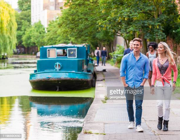 visiting regent's canal durign summer - camden london stock pictures, royalty-free photos & images