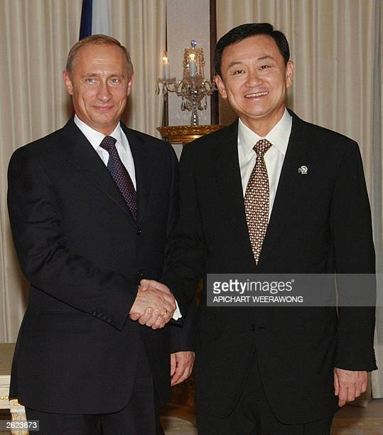 Visiting Russian President Vladimir Putin and Thai Prime Minister Thaksin Shinawatra shake hands prior to their meeting at Government House in...