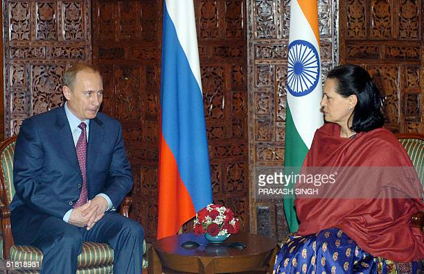 Visiting Russian President Vladimir Putin talks with India's Congress Party President and Chairperson of the United Progressive Alliance Government...
