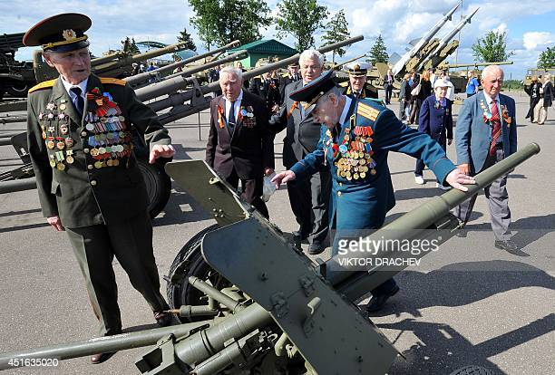 Visiting Russian World War II veterans look at a WWIIera Soviet 45mm antitank gun nicknamed 'Farewell to the Motherland' on the front lines while...