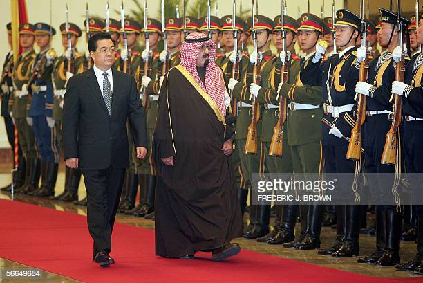 Visiting Saudi King Abdullah walks beside Chinese President Hu Jintao during a review of the honour guard welcoming ceremony at the Great Hall of the...