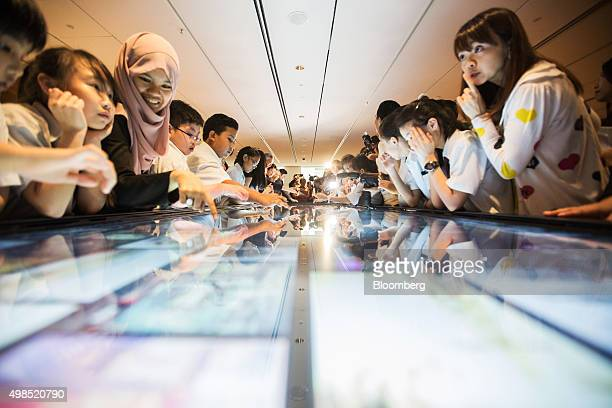 Visiting school children looks at an interactive media panel at the opening of the National Gallery Singapore in Singapore on Monday Nov 23 2015 The...