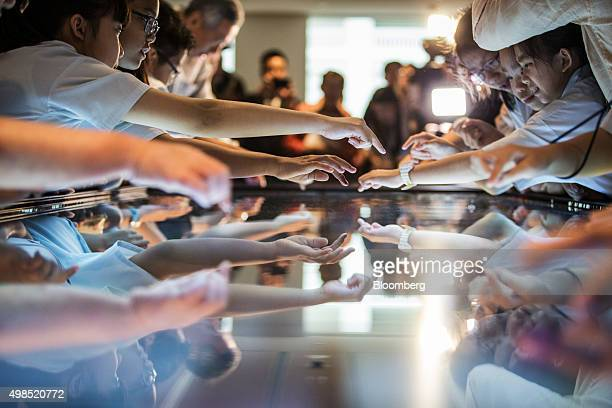 Visiting school children use an interactive media panel at the opening of the National Gallery Singapore in Singapore on Monday Nov 23 2015 The new...