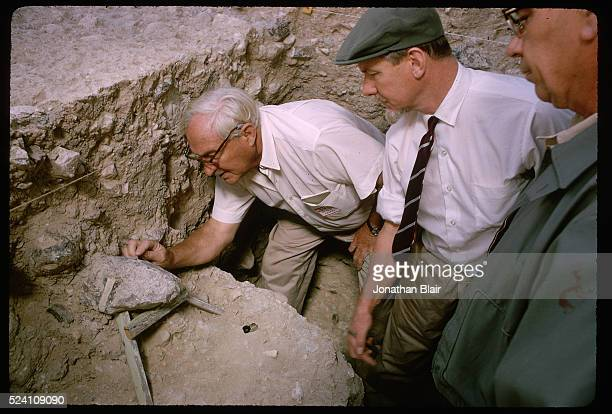 Visiting scientists gather around Dr. Louis Leakey to see the artifacts that have been recovered at the Calico Hills, Early Man, dig site in Yermo,...