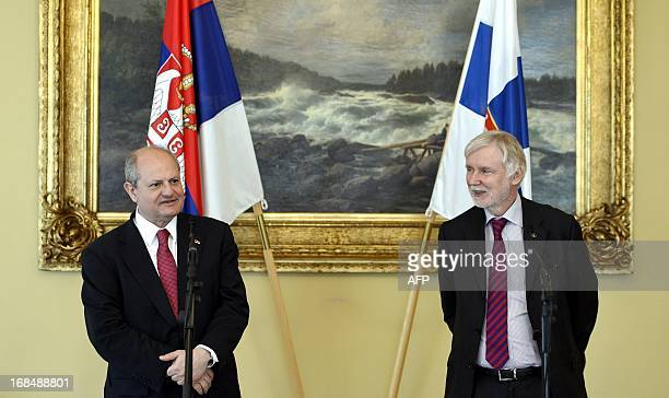 Visiting Serbian Foreign Minister Ivan Mrkic attends a press conference with his Finnish counterpart Erkki Tuomioja in Helsinki Finland on May 10...