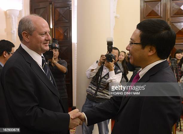 Visiting Serbian Foreign Minister Ivan Mrkic is greeted by his Vietnamese counterpart Pham Binh Minh in Hanoi on March 1 2013 The Serbian diplomat is...