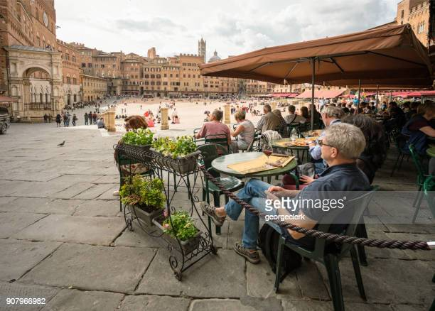 visiting siena - piazza del campo - siena italy stock photos and pictures