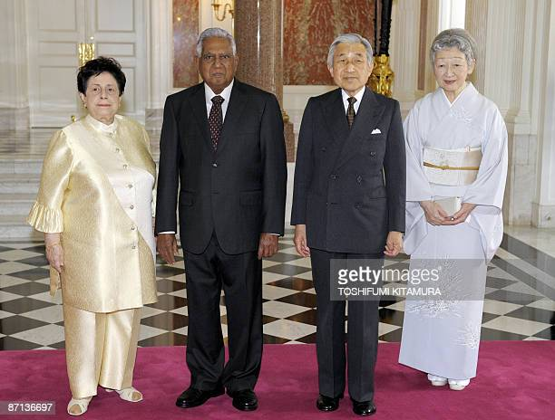 Visiting Singaporean President S R Nathan and his wife Urmila pose for photographs with Japanese Emperor Akihito and Empress Michiko at the entrance...