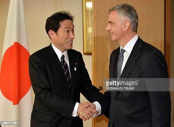 Visiting Swiss President and Foreign Minister Didier Burkhalter shakes hands with Japanese Foreign Minister Fumio Kishida prior to their talks at...