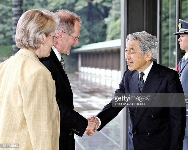 Visiting Swiss President Joseph Deiss accompanied by his wife Elizabeth shakes hands with Japanese Emperor Akihito upon his arrival at the Imperial...