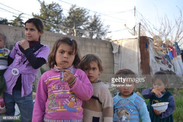 Visiting Syrian refugees in Lebanon's Bekaa Valley. These children all live in a make-shift unregistered refugee camp on the side of the...