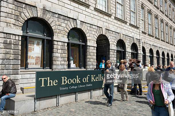 visiting the book of kells at trinity college in dublin, ireland - book of kells stock pictures, royalty-free photos & images