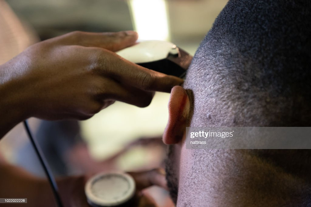 Visiting the local township barber : Stock Photo