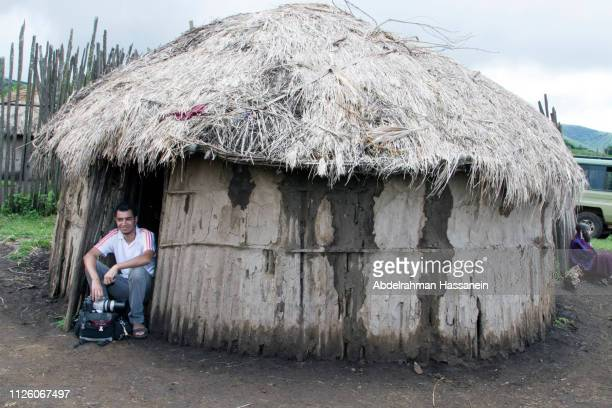 visiting the masai boma - eastern african tribal culture stock photos and pictures