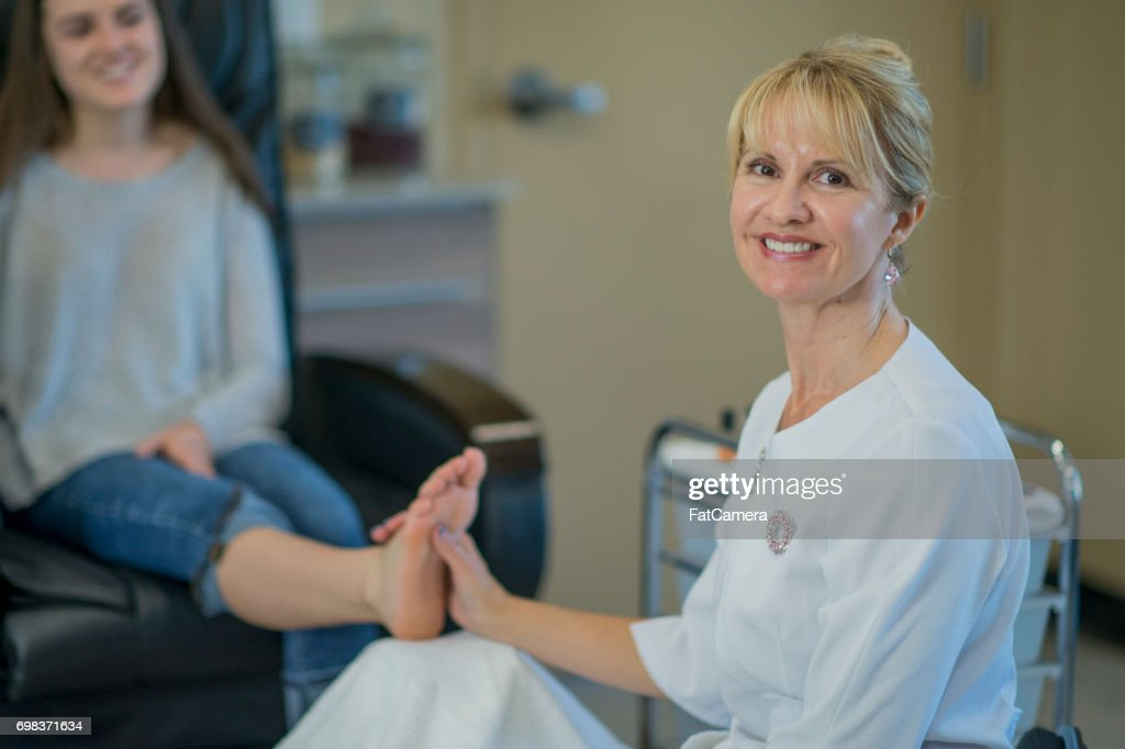 Visiting the Nail Studio for a Pedicure : Stock Photo
