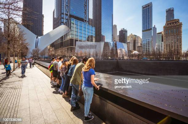visiting the national september 11 memorial in new york city - national landmark stock pictures, royalty-free photos & images