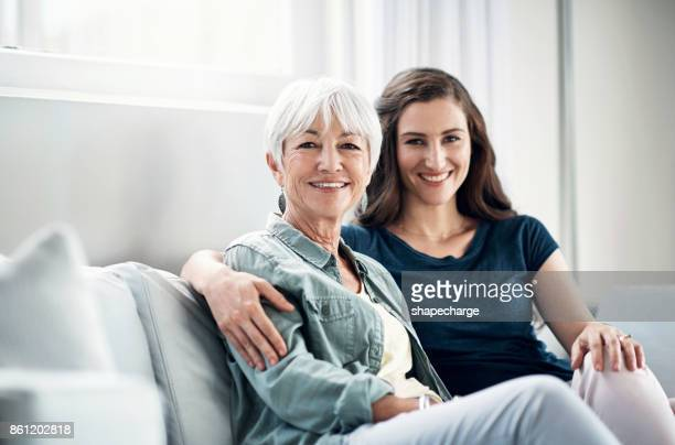 visiting time is valuable time - mother daughter stock photos and pictures
